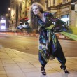 Stock Photo: Elegant woman on city street at night