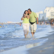Happy seniors couple  on beach — Stock Photo