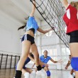 Girls playing volleyball indoor game — Foto Stock