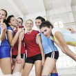 Girls playing volleyball indoor game — Stock Photo #3628788