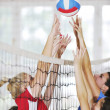Girls playing volleyball indoor game — Stock Photo #3629520