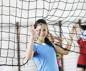 Girls playing volleyball indoor game — Стоковое фото