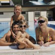 Happy young family have fun on swimming pool — Stock Photo #3669999
