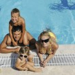 Happy young family have fun on swimming pool — Stock Photo #3670002