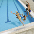 Happy young family have fun on swimming pool — 图库照片