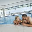 Happy cople at swimming pool — Stock Photo