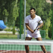 Stock Photo: Young man play tennis outdoor