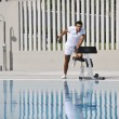 Stock Photo: Young healthy athlete man exercise at poolside