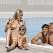Happy young family have fun on swimming pool — Stock Photo #3682889