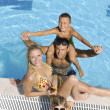 Happy young family have fun on swimming pool — Stock Photo #3682900