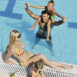 Happy young family have fun on swimming pool — Foto Stock