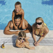 Happy young family have fun on swimming pool — Stock Photo #3682975