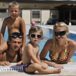 Happy young family have fun on swimming pool — Stock fotografie