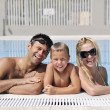 Royalty-Free Stock Photo: Happy young family have fun on swimming pool