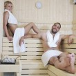 Happy cople relaxing at swimming pool — Stock Photo