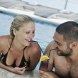 Happy cople relaxing at swimming pool — Stock Photo #3683466