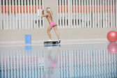 Fitness exercise at poolside — Stock Photo