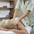 Woman at spa and wellness back massage — Stock Photo