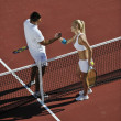 Happy young couple play tennis game outdoor — Stock Photo #3802265