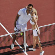 Happy young couple play tennis game outdoor — Stock Photo #3864812