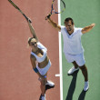 Happy young couple play tennis game outdoor — Stock Photo