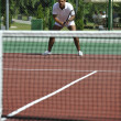 Young man play tennis outdoor — Stock Photo #3864853