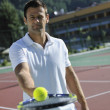 Young man play tennis outdoor — Stock Photo #3864858