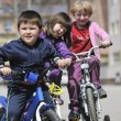 Royalty-Free Stock Photo: Happy childrens group learning to drive bicycle