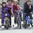 Happy childrens group learning to drive bicycle — Stock Photo