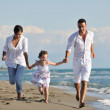 Happy young family have fun on beach — Stock Photo #4352969
