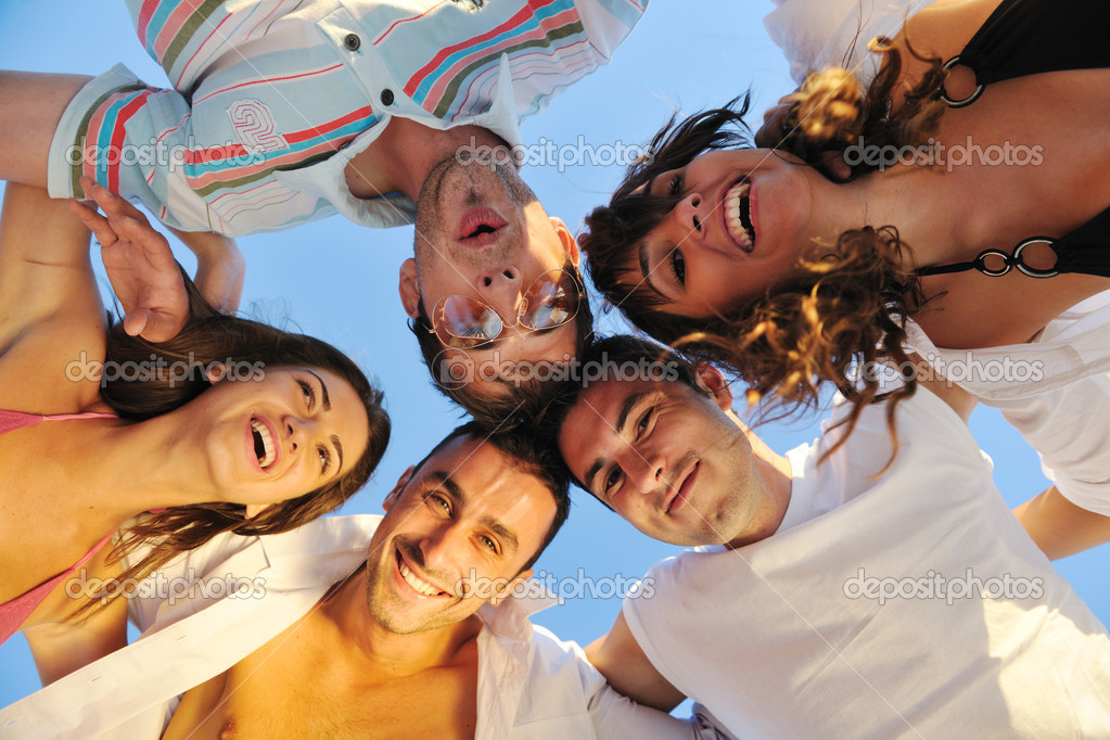 Happy young group have fun white running and jumping on beacz at sunset time — Stock Photo #4360176