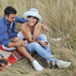 Happy couple enjoying countryside picnic in long grass — Stock Photo #4381872