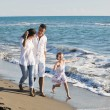 Happy young family have fun on beach — Stock Photo #4385656