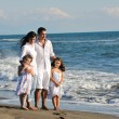 Happy young family have fun on beach — Stock Photo #4387140