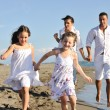 Happy young family have fun on beach — Foto de Stock