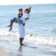 Happy young couple have fun at beautiful beach — Stock Photo #4390481