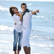 Happy young couple have fun at beautiful beach — Stock Photo #4390493