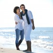 Happy young couple have fun at beautiful beach — Stock Photo #4390495