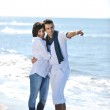 Happy young couple have fun at beautiful beach — Stock Photo #4390501