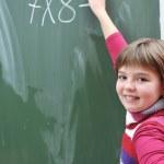 Happy school girl on math classes — Stock Photo #4399122