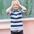 Happy young boy at first grade math classes — Foto Stock