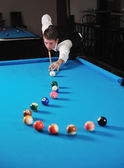 Young man play pro billiard game — Stock Photo