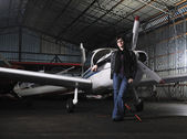 Young woman with private airplane — Stock Photo