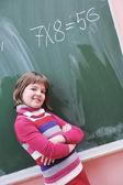 Happy school girl on math classes — Stock Photo