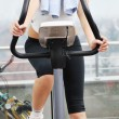 Stock Photo: Womanworkout in fitness club on running track machine