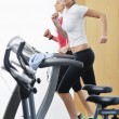 Womanworkout in fitness club on running track machine — Stock Photo #4770911