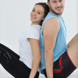 Happy young couple fitness workout and fun — Stock Photo #4774258