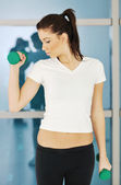 Womanworkout in fitness club on running track machine — ストック写真