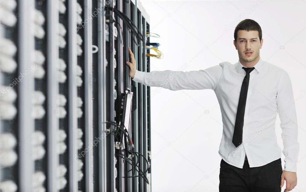 Young handsome business man it  engeneer in datacenter server room — Stock Photo #4786730