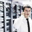 Business man practice yoga at network server room — Stock Photo #4791913